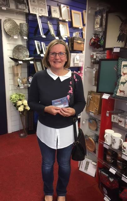 Heather McCready collecting her Home Hardware vouchers